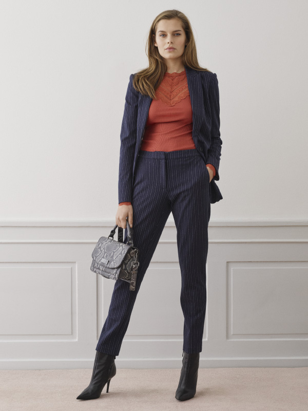 Elegant suiting styled with feminine essentials for a fashionable look