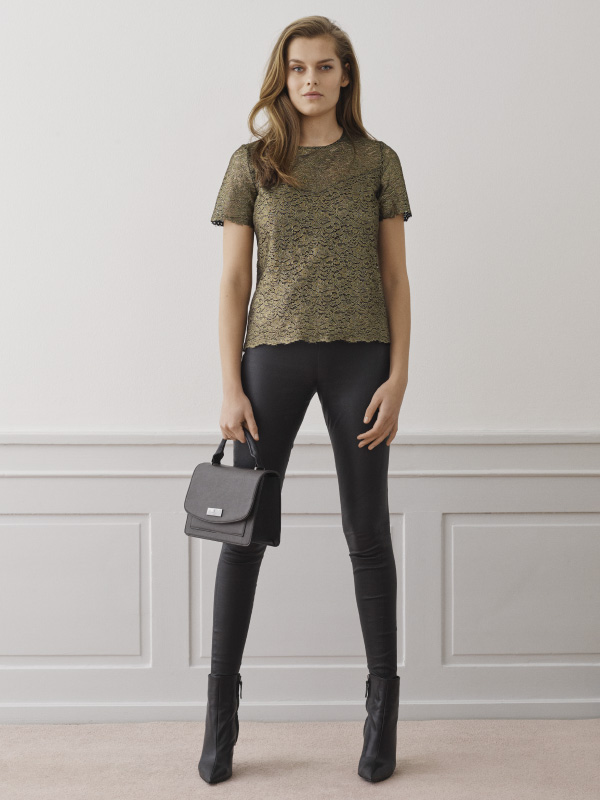 The luxurious leather trousers elevate any look and match perfectly our rich gold lace blouse