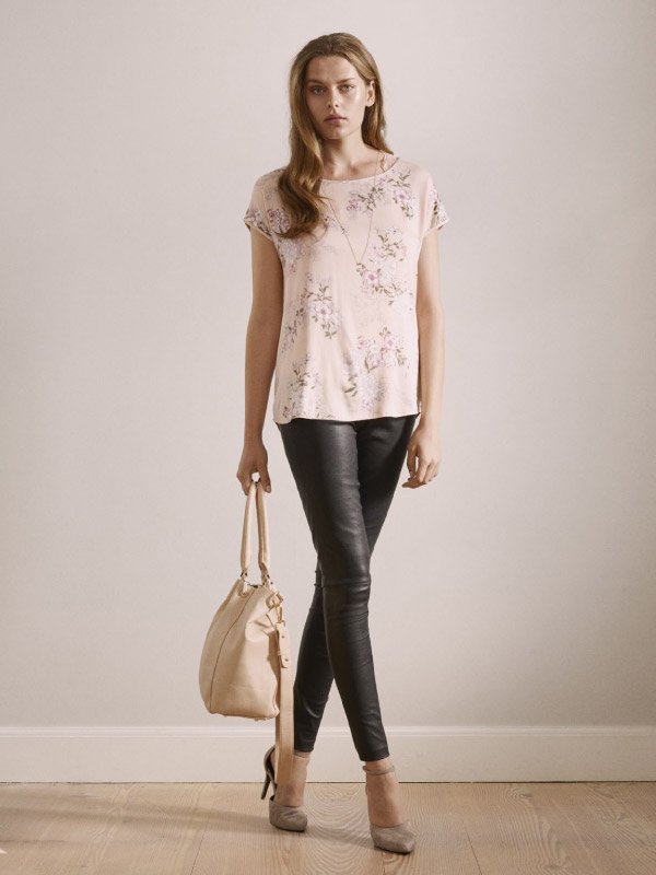 Looking absolutely stylish in t-shirt and cool leather trousers