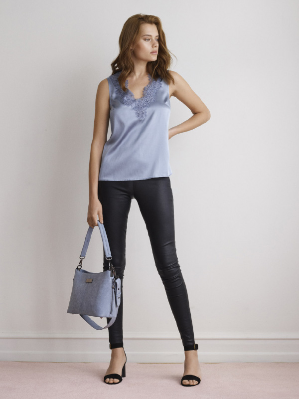 THE LUXURIOUS LEATHER LEGGINS STYLED WITH THE SEASONAL SILK TOP CREATING THE PERFECT LOOK