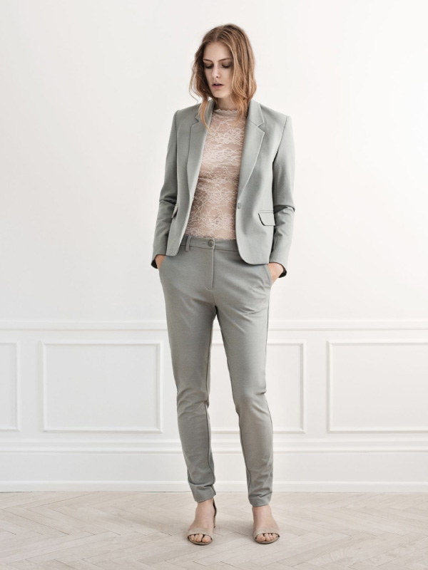 Lace details and a classic suit